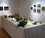 Banquet, table installation of vegetation, silk and plastic flowers, wax, 12' x 4' x 4'