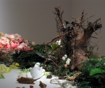 Banquet, (detail)table installation of vegetation, silk and plastic flowers, wax, 12' x 4' x 4'